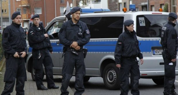 Police  block a street in Alsdorf, near Aachen, western Germany, Tuesday, Nov. 17, 2015. German police have arrested three people in Alsdorf near Aachen in connection with the Paris attacks, the dpa news agency reported Tuesday.  (AP Photo/Hermann J. Knippertz)